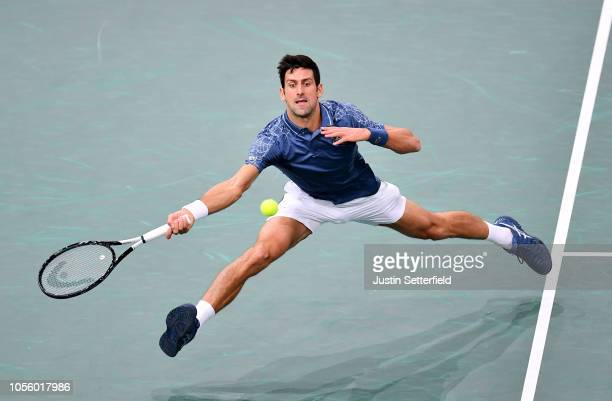 Novak Djokovic of Serbia plays a forehand in his Round of 16 match against Damir Dzumhur of Bosnia during Day 4 of the Rolex Paris Masters on...