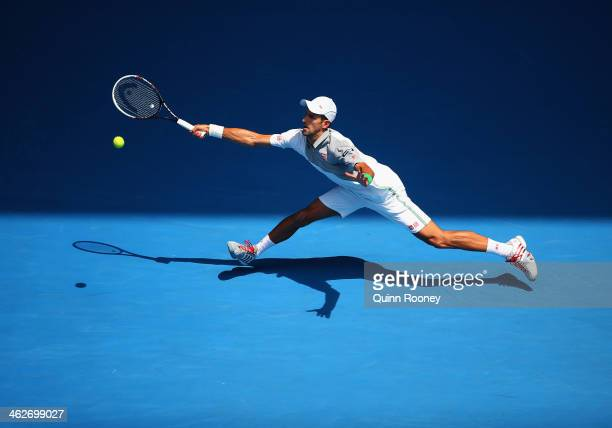 Novak Djokovic of Serbia plays a forehand in his second round match against Leonardo Mayer of Argentina during day three of the 2014 Australian Open...