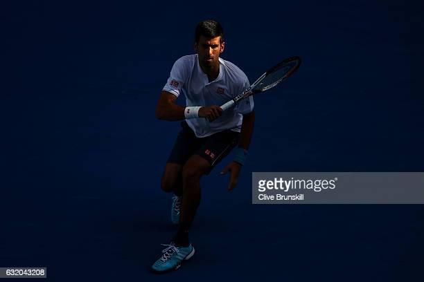 Novak Djokovic of Serbia plays a forehand in his second round match against Denis Istomin of Uzbekistan on day four of the 2017 Australian Open at...