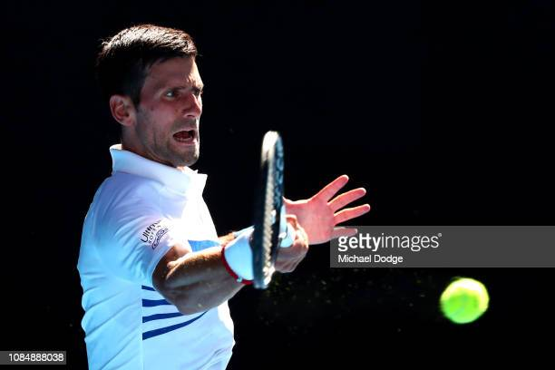 Novak Djokovic of Serbia plays a forehand in his third round match against Denis Shapovalov of Canada during day six of the 2019 Australian Open at...