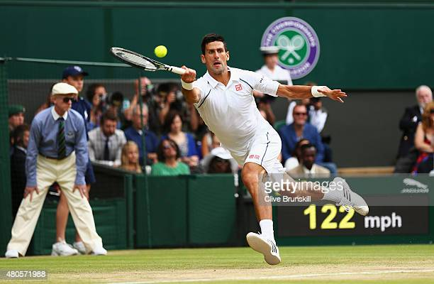 Novak Djokovic of Serbia plays a forehand in the Final of The Gentlemen's Singles against Roger Federer of Switzerland on day thirteen of the...