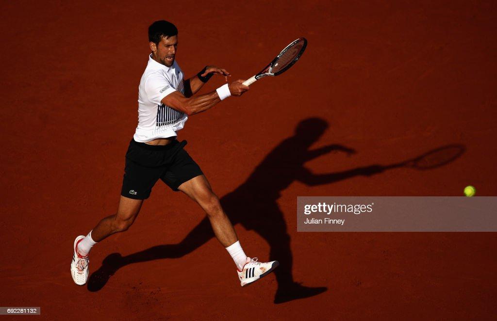 Novak Djokovic of Serbia plays a forehand in the mens singles fourth round match against Albert Ramos-Vinolas of Spain on day eight of the 2017 French Open at Roland Garros on June 4, 2017 in Paris, France.