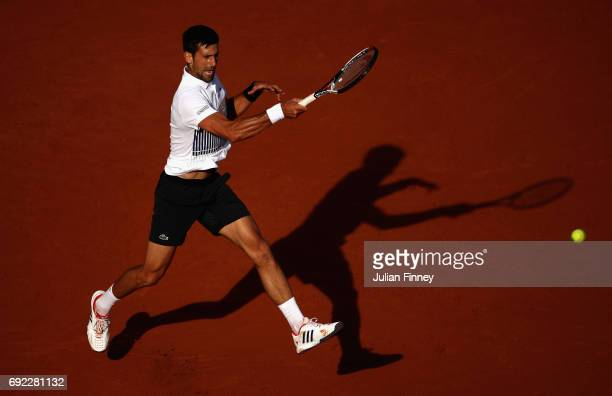 Novak Djokovic of Serbia plays a forehand in the mens singles fourth round match against Albert RamosVinolas of Spain on day eight of the 2017 French...