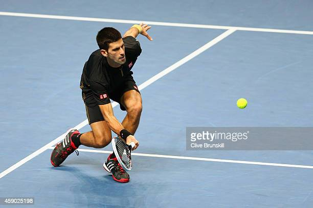 Novak Djokovic of Serbia plays a forehand in the singles semifinal match against Kei Nishikori of Japan on day seven of the Barclays ATP World Tour...