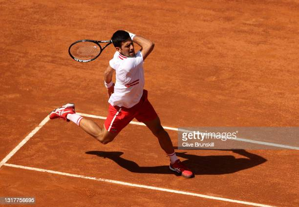 Novak Djokovic of Serbia plays a forehand in their men's singles third round match against Davidovich Fokina of Spain during Day Six of the...