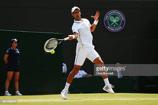 Novak Djokovic of Serbia plays a forehand return during his Gentlemen's Singles quarterfinal match against Marin Cilic of Croatia on day nine of the...