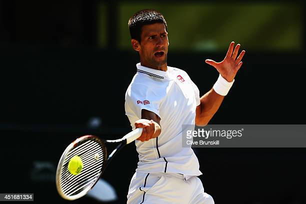 Novak Djokovic of Serbia plays a forehand return during his Gentlemen's Singles semifinal match against Grigor Dimitrov of Bulgaria on day eleven of...
