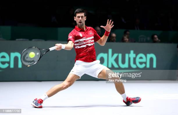 Novak Djokovic of Serbia plays a forehand shot during his Davis Cup group stage match against Yoshihito Nishioka of Japan during Day Three of the...