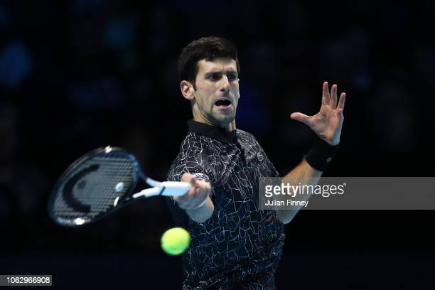 Novak Djokovic of Serbia plays a forehand shot in his semi finals singles match against Kevin Anderson of South Africa during Day Seven of the Nitto...