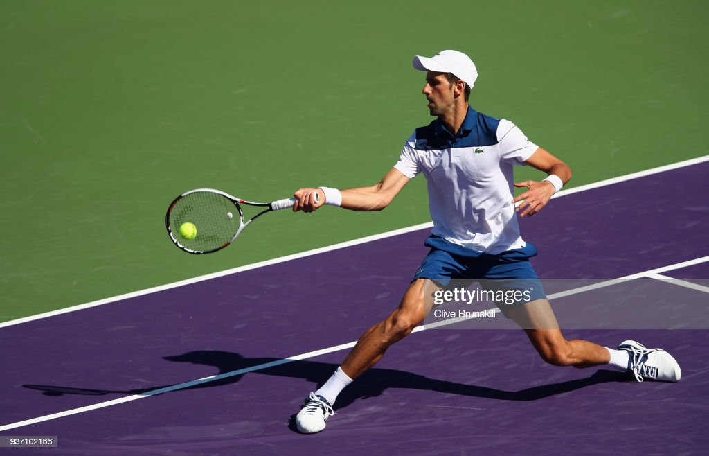 Novak Djokovic of Serbia plays a forehand volley against Benoit Paire of France in their second round match during the Miami Open Presented by Itau at Crandon Park Tennis Center on March 23, 2018 in Key Biscayne, Florida.