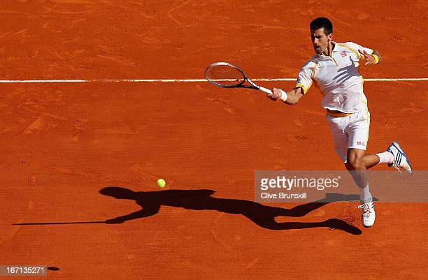 Novak Djokovic of Serbia plays a forehand volley against Rafael Nadal of Spain in their final match during day eight of the ATP Monte Carlo Mastersat...