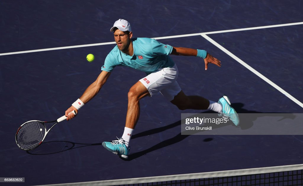 Novak Djokovic of Serbia plays a forehand volley during his straight set defeat by Nick Kyrgios of Australia in their fourth round match during day ten of the BNP Paribas Open at Indian Wells Tennis Garden on March 15, 2017 in Indian Wells, California.