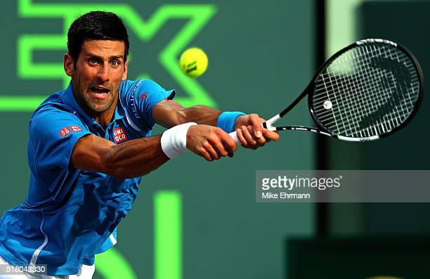Novak Djokovic of Serbia plays a match against Dominic Thiem of Austria during Day 9 of the Miami Open presented by Itau at Crandon Park Tennis...
