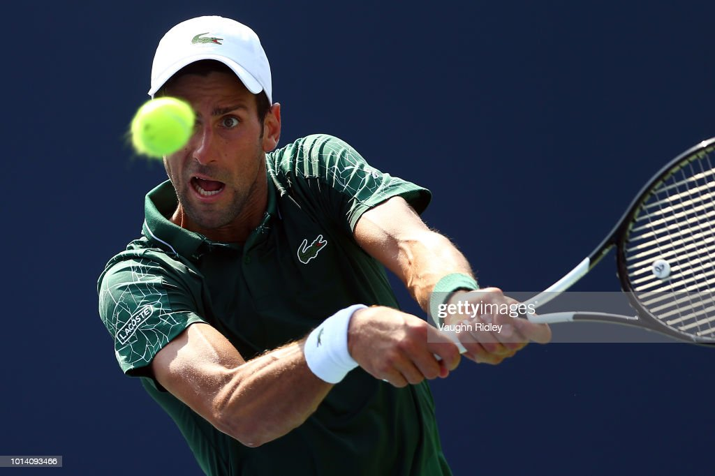 Novak Djokovic of Serbia plays a shot against Stefanos Tsitsipas of Greece during a 3rd round match on Day 4 of the Rogers Cup at Aviva Centre on August 9, 2018 in Toronto, Canada.