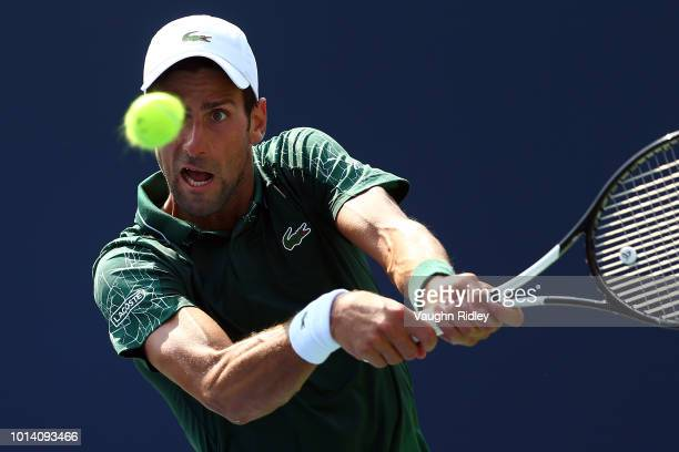 Novak Djokovic of Serbia plays a shot against Stefanos Tsitsipas of Greece during a 3rd round match on Day 4 of the Rogers Cup at Aviva Centre on...