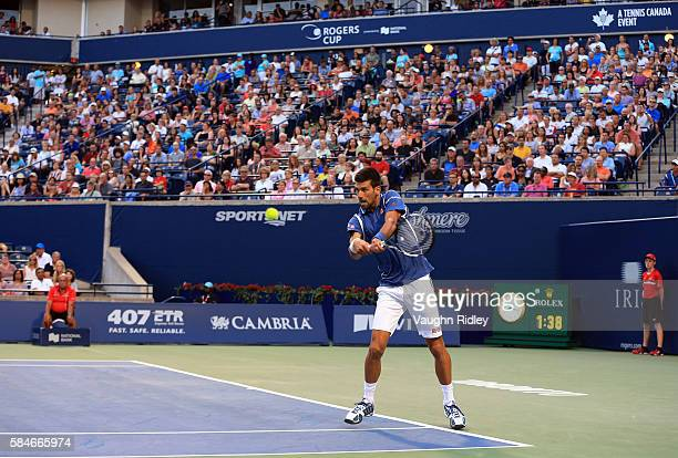 Novak Djokovic of Serbia plays a shot against Tomas Berdych of Czech Republic during Day 5 of the Rogers Cup at the Aviva Centre on July 29 2016 in...