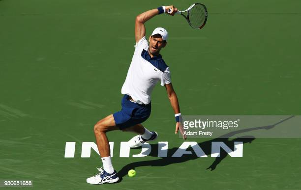 Novak Djokovic of Serbia plays a shot during his match against Taro Daniel of Japan during the BNP Paribas Open at the Indian Wells Tennis Garden of...