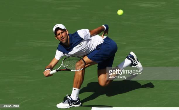 Novak Djokovic of Serbia plays a shot during his match against Taro Daniel of Japan during the BNP Paribas Open at the Indian Wells Tennis Garden of...