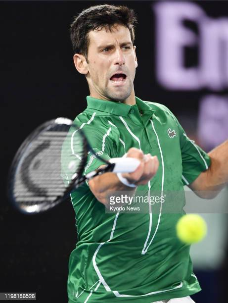 Novak Djokovic of Serbia plays a shot during the Australian Open tennis final against Dominic Thiem of Austria on Feb 2 in Melbourne