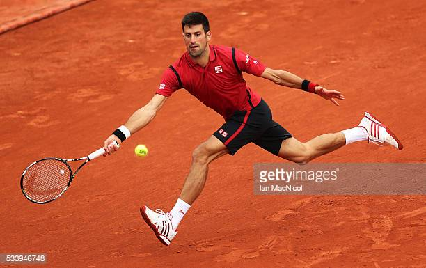 Novak Djokovic of Serbia plays a shot during the Men's Singles first round match against YenHsmen of Chinese Taipei on day three of the 2016 French...