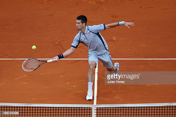 Novak Djokovic of Serbia plays a volley in his match against Grigor Dimitrov of Bulgaria during day four of the Mutua Madrid Open tennis tournament...