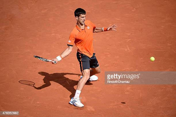 Novak Djokovic of Serbia plays against Stanislas Wawrinka of Switzerland on day fifteen of the 2015 French Open at Roland Garros on June 7 2015 in...