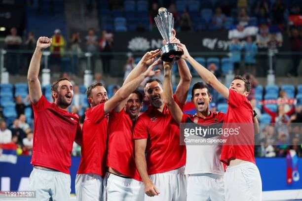 Novak Djokovic of Serbia pose with the ATP Cup trophy after winning the ATP Cup final against Spain during day 10 of the ATP Cup at Ken Rosewall...