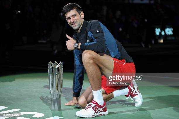 Novak Djokovic of Serbia pose with trophy after winning his men's singles final match against Borna Coric of Croatia in the Men's singles final match...