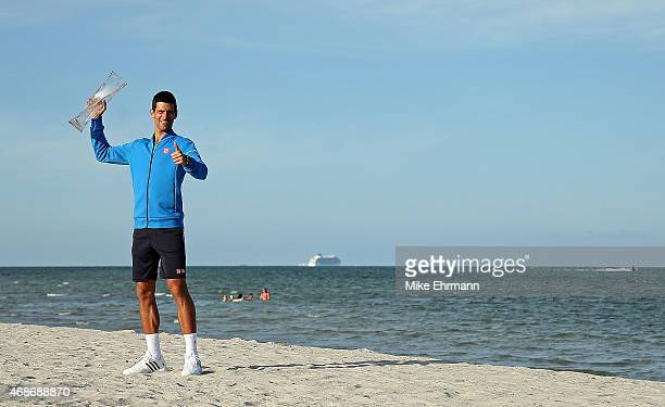 Novak Djokovic of Serbia poses at Crandon Park after winning the Men's Final of the Miami Open presented by Itau against Andy Murray of Great...