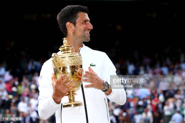 Novak Djokovic of Serbia poses for a photo with the trophy after winning his Men's Singles final against Roger Federer of Switzerland during Day...