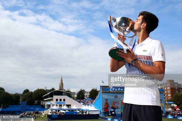 Novak Djokovic of Serbia poses for a photo with the trophy after winning the men's singles final against Gael Monfils of France during day seven of...