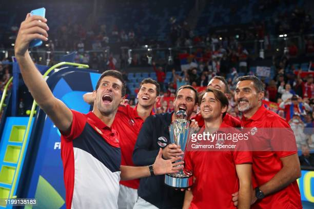 Novak Djokovic of Serbia poses for a selfie with team mates after winning the ATP Cup final against Spain during day 10 of the ATP Cup at Ken...