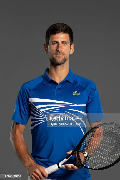 Novak Djokovic of Serbia poses for his official portrait at the Australian Open at Melbourne Park on January 13, 2019 in Melbourne, Australia.
