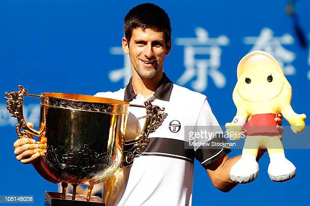 Novak Djokovic of Serbia poses for photographers after defeating David Ferrer of Spain during the final on day eleven of the 2010 China Open at the...