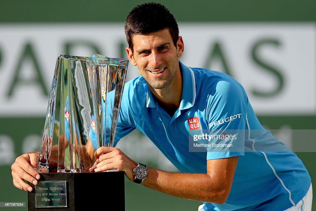 Novak Djokovic of Serbia poses for photographers after defeating Roger Federer of Switzerland during the final on day fourteen of the BNP Paribas Open at the Indian Wells Tennis Garden on March 22, 2015 in Indian Wells, California.