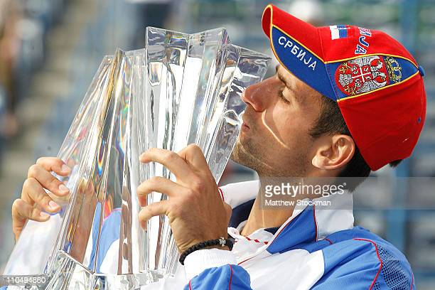 Novak Djokovic of Serbia poses for photographers with the winner's trophy after defeating Rafael Nadal of Spain during the final of the BNP Paribas...