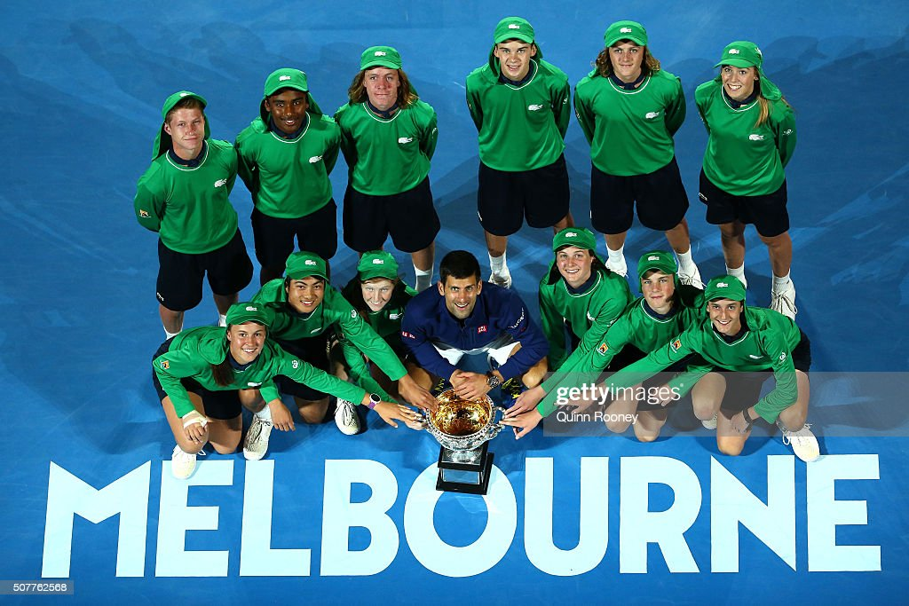 Novak Djokovic of Serbia poses with ball kids and the Norman Brookes Challenge Cup after winning the Men's Singles Final over Andy Murray of Great Britain during day 14 of the 2016 Australian Open at Melbourne Park on January 31, 2016 in Melbourne, Australia.