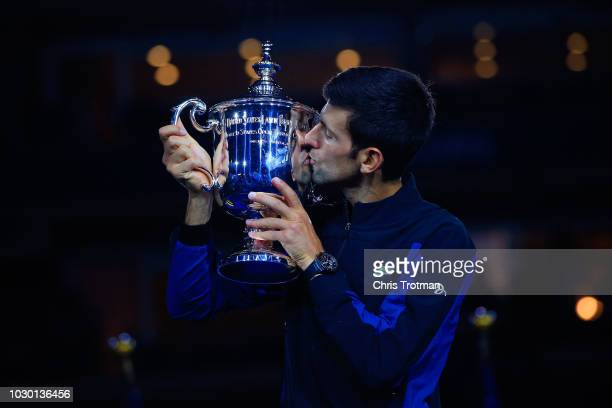 Novak Djokovic of Serbia poses with championship trophy after winning his Men's Singles final match against Juan Martin del Potro of Argentina on Day...