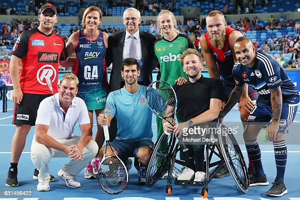 Novak Djokovic of Serbia poses with current and past Australian sporting icons Aaron Finch of the Melbourne Stars former netballer Sharelle McMahon...