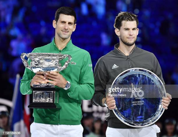 Novak Djokovic of Serbia poses with Dominic Thiem of Austria after beating him in the Australian Open tennis final on Feb 2 in Melbourne