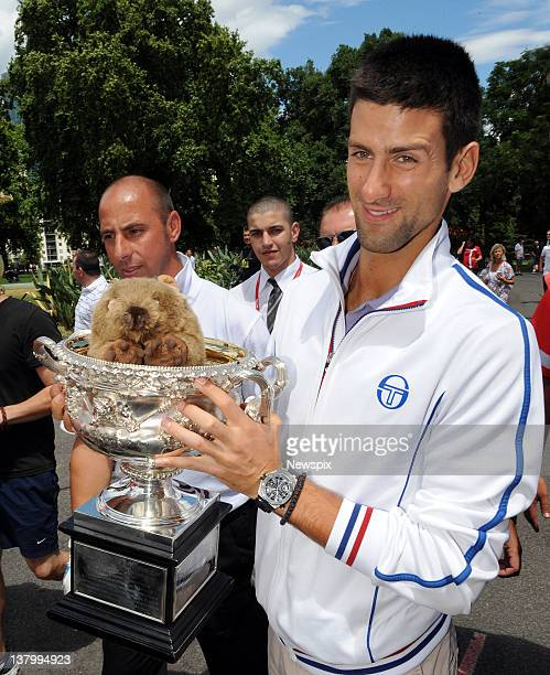 Novak Djokovic of Serbia poses with 'Fatso the Wombat' in the Norman Brookes Challenge Cup after winning the 2012 men's Australian Open at Carlton...