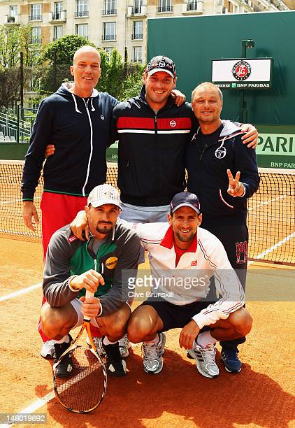 Novak Djokovic of Serbia poses with his team including hitting partner Dusan Vemic and physical trainer Gebhard PhilGritsch physiotherapist Milan...
