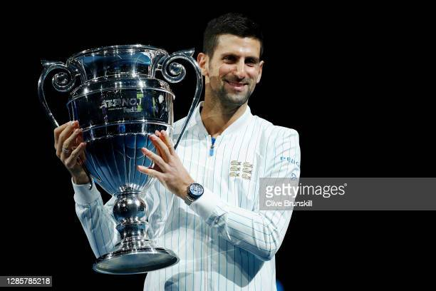Novak Djokovic of Serbia poses with his trophy after being announced as ATP Tour end of year world number one during Day one of the Nitto ATP World...
