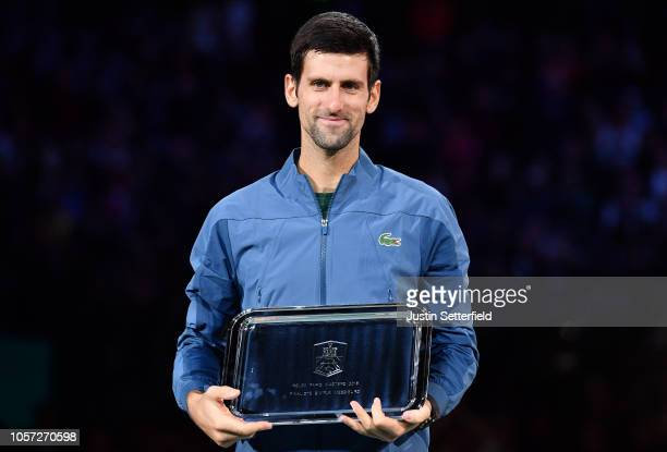 Novak Djokovic of Serbia poses with his trophy after he loses his match against Karen Khachanov of Russia during the Men's Final during Day Seven of...