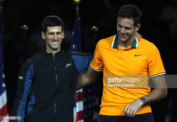 Novak Djokovic of Serbia poses with Juan Martin del Potro of Argentina after winning his men's Singles finals match on Day Fourteen of the 2018 US...