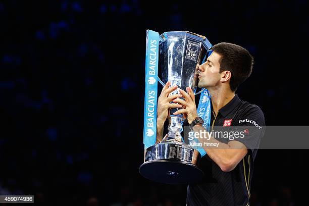 Novak Djokovic of Serbia poses with the ATP trophy on day eight of the Barclays ATP World Tour Finals at O2 Arena on November 16 2014 in London...