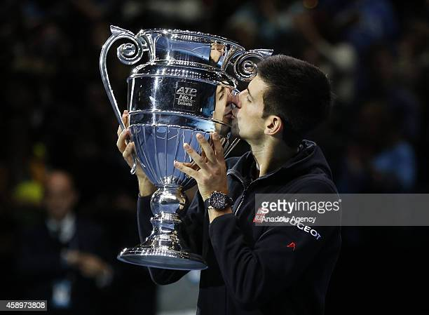 Novak Djokovic of Serbia poses with the Barclays ATP World Tour No 1 Award after the round robin singles match against Tomas Berdych of Czech...