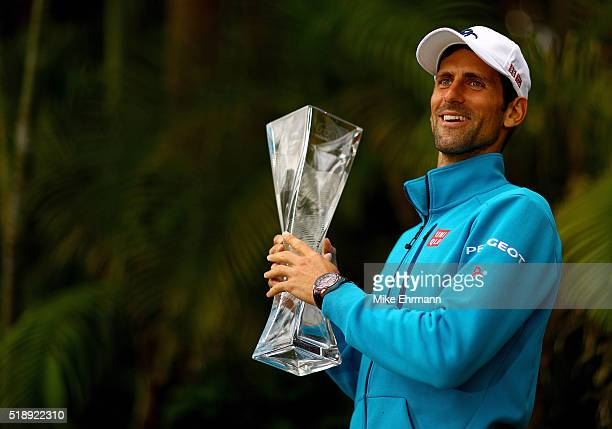 Novak Djokovic of Serbia poses with the Butch Buchholz Trophy after winning the Men's Final against Kei Nishikori of Japan during Day 14 of the Miami...