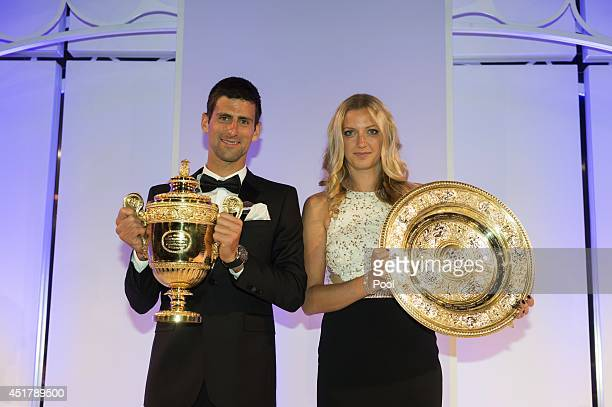 Novak Djokovic of Serbia poses with the Gentlemen's Singles Trophy and Petra Kvitova of the Czech Republic poses with the Venus Rosewater Dish trophy...