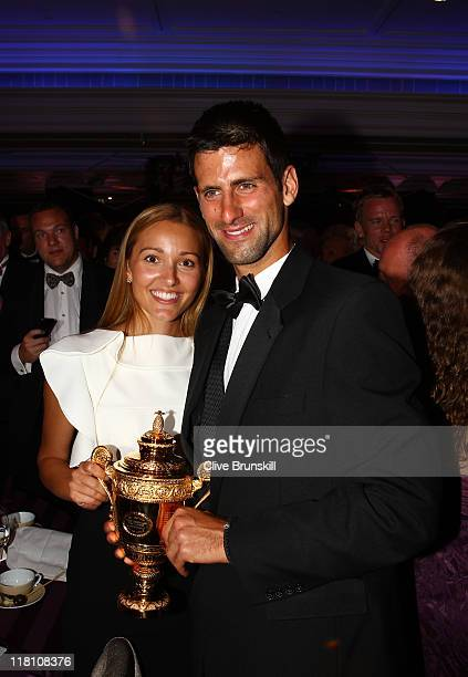 Novak Djokovic of Serbia poses with the mens replica trophy with his girlfriend Jelena Ristic at the Wimbledon Championships 2011 Winners Ball at the...